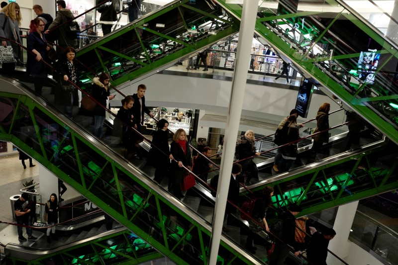 Shoppers use escalators as they visit a shopping mall in Warsaw