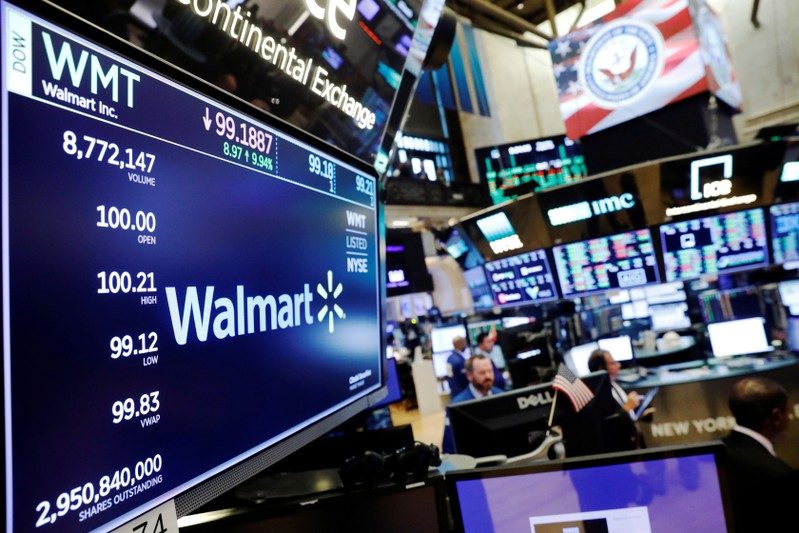 FILE PHOTO: A Walmart logo is displayed above the floor of the New York Stock Exchange shortly after the opening bell in New York