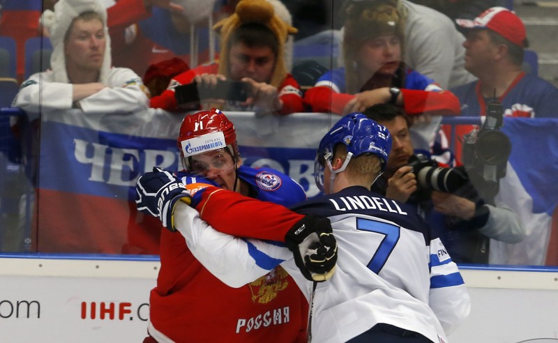 Russia's Malkin scuffles with Finland's Esa Lindell during their Ice Hockey World Championship game at the CEZ arena in Ostrava