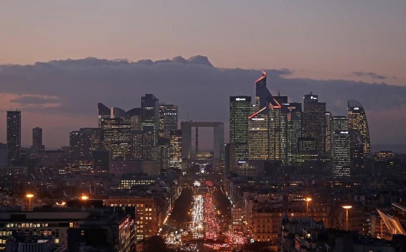 FILE PHOTO: The financial district of La Defense is seen at dusk near Paris