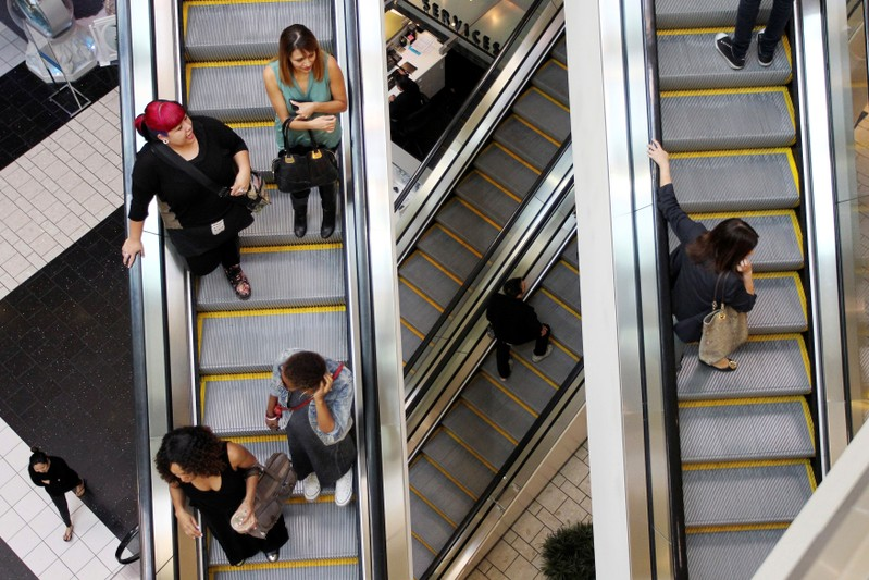 FILE PHOTO: Shoppers ride escalators at the Beverly Center mall in Los Angeles