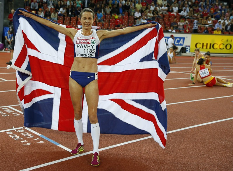 FILE PHOTO: Pavey of Britain celebrates after winning the women's 10,000 metres race during European Athletics Championships in Zurich