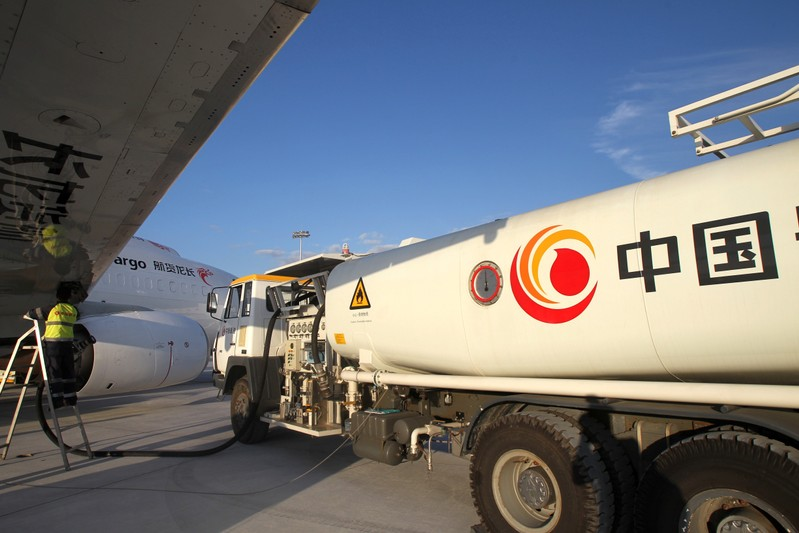 Worker refuels a cargo aircraft with aviation fuel at an airport in Nantong