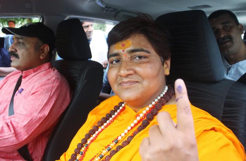 Pragya Singh Thakur, leader of ruling Bharatiya Janata Party (BJP), shows her ink-marked finger after casting her vote, outside a polling station in Bhopal