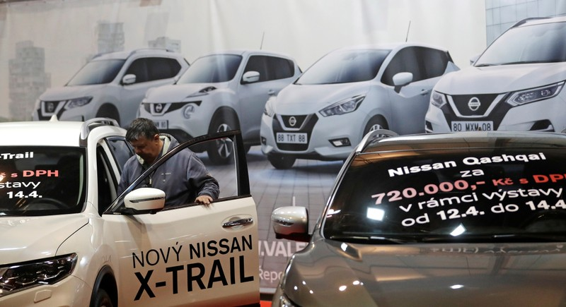 A visitor looks at a Nissan car during the Prague Autoshow in Prague