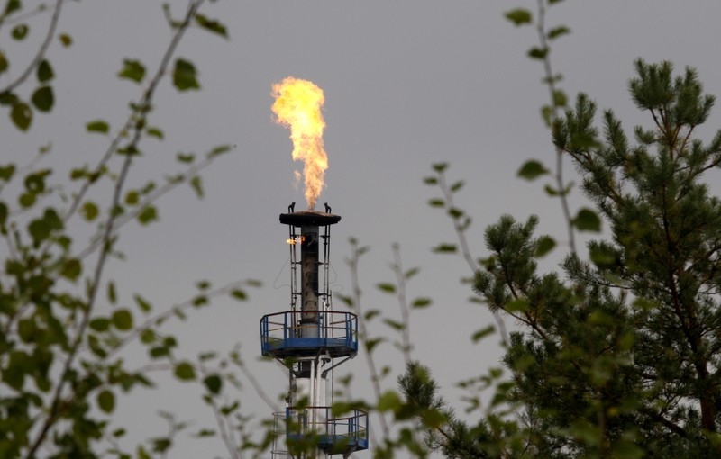 A flame burning natural gas is seen at an oil refinery located on a branch of the Druzhba oil pipeline, which moves crude through the pipeline westwards to Europe, near Mozyr