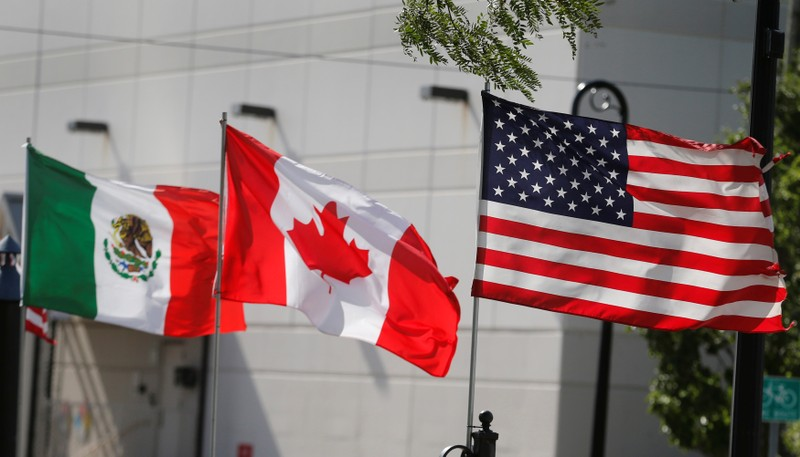 Flags of the U.S., Canada and Mexico fly next to each other in Detroit, Michigan