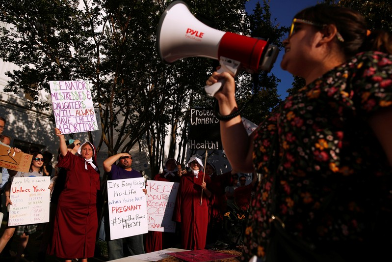 FILE PHOTO - Pro-choice supporters protest in front of the Alabama State House as Alabama state Senate votes on the strictest anti-abortion bill in the United States at the Alabama Legislature in Montgomery
