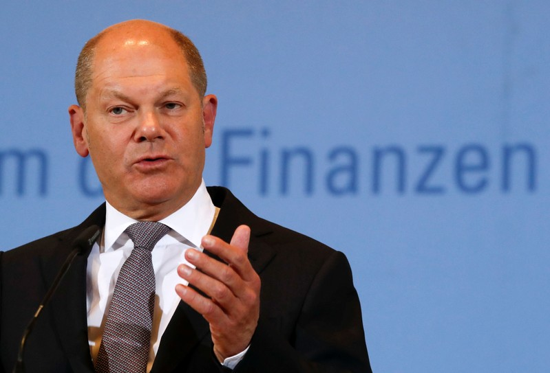Finance Minister Olaf Scholz addresses a news conference to present the results of the latest tax revenue estimate in Berlin