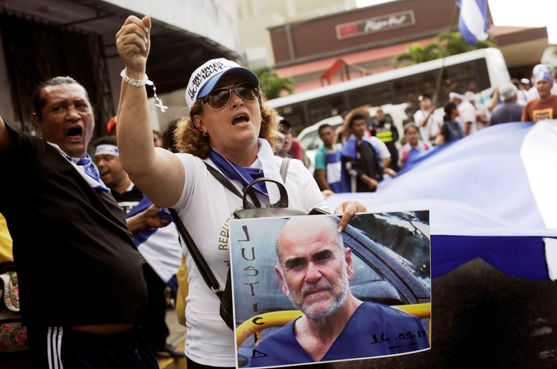 A Nicaraguan living in Costa Rica holds a portrait of U.S. citizen Eddy Montes while protesting in support of him in front of the Nicaragua Embassy in San Jose