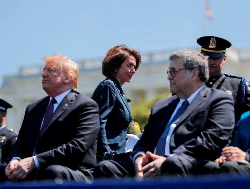 FILE PHOTO: Speaker of the House Pelosi walks behind President Trump and Attorney General Barr as they attend National Peace Officers Memorial Service on Capitol Hill in Washington