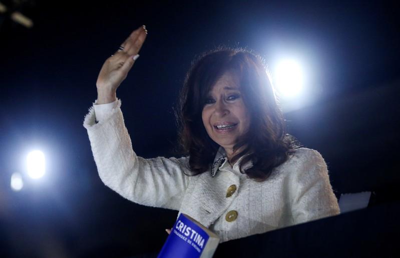 Argentina's former President Cristina Fernandez de Kirchner waves to supporters after the presentation of her book