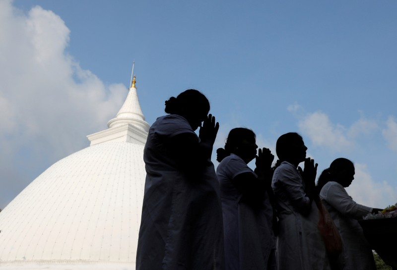 Buddhist devotees worship at the Kelaniya Buddhist temple during Vesak Day, commemorating the birth, enlightenment and death of Buddha, in Colombo