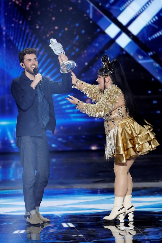 Israel's Netta Barzilai, winner of last year's Eurovision Song Contest, hands the trophy to Duncan Laurence of the Netherlands, the winner of the 2019 Eurovision Song Contest in Tel Aviv, Israel