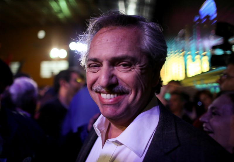 FILE PHOTO: Presidential candidate Alberto Fernandez of the Unidad Ciudadana party, smiles during a rally in Buenos Aires