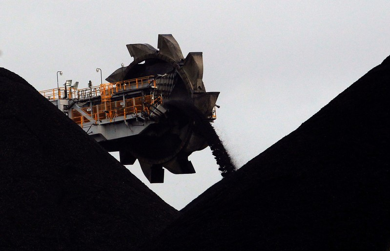 A reclaimer places coal in stockpiles at the coal port in Newcastle
