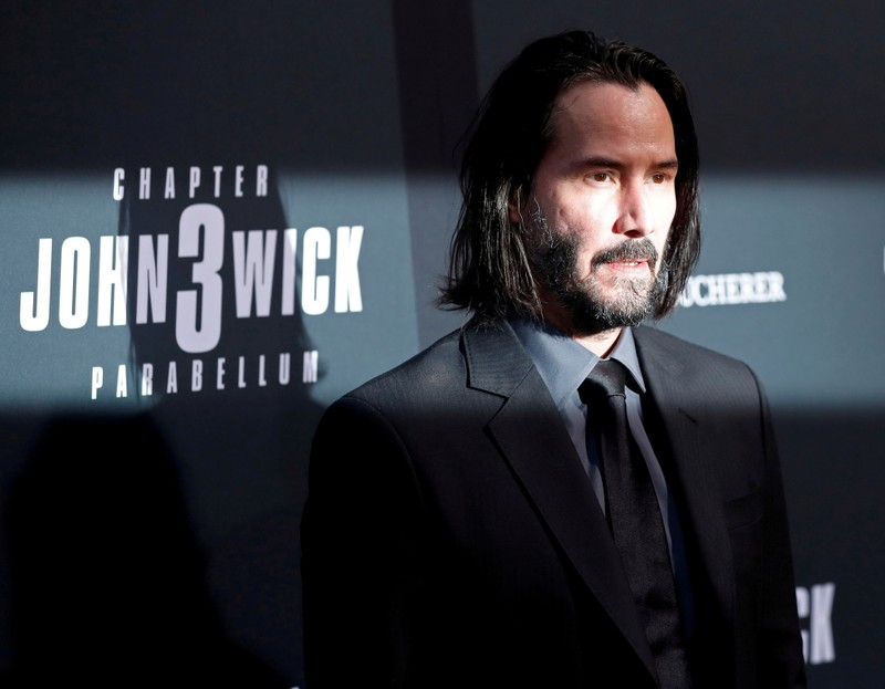 FILE PHOTO: Cast member Keanu Reeves arrives for a screening of the movie