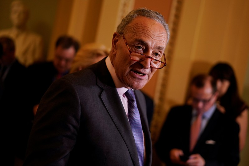 FILE PHOTO: Senate Minority Leader Chuck Schumer speaks with reporters following the weekly policy luncheons on Capitol Hill