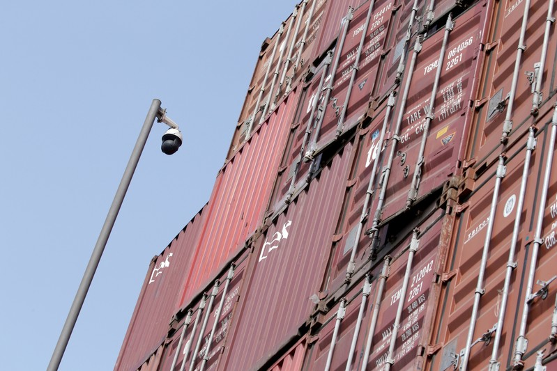 A surveillance camera is seen next to containers at a logistics center near Tianjin Port
