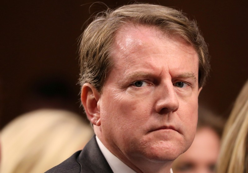 FILE PHOTO: White House Counsel Don McGahn listens during the confirmation hearing for U.S. Supreme Court nominee Kavanaugh on Capitol Hill in Washington