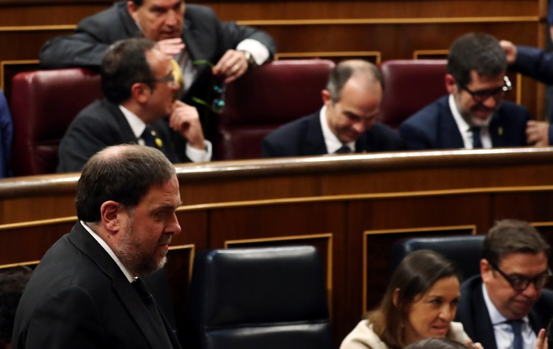 Jailed Catalan politicians Junqueras walks past jailed catalan politicians Sanchez, Rull and Turull during the first session of parliament following a general election in Madrid