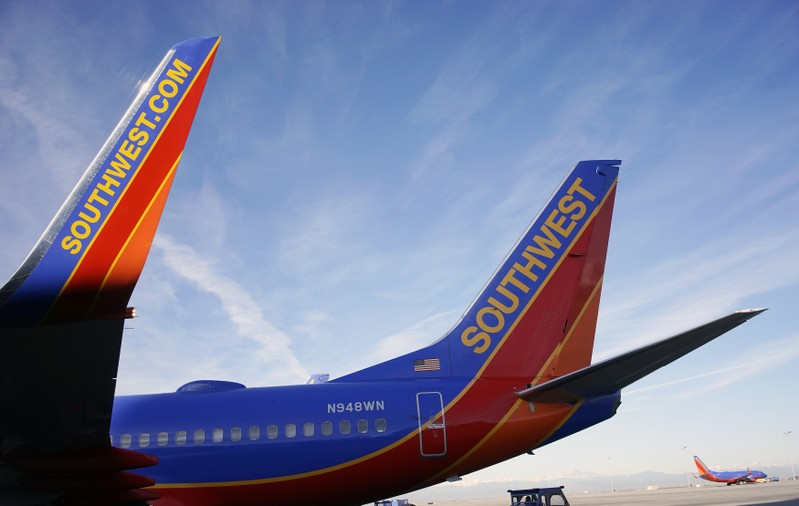 FILE PHOTO: A Southwest Airlines jet waits on the tarmac at Denver International Airport in Denver
