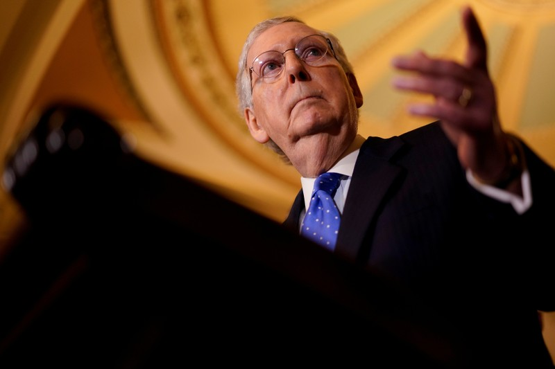 FILE PHOTO - Senate Majority Leader Mitch McConnell speaks with reporters following the weekly policy luncheons on Capitol Hill