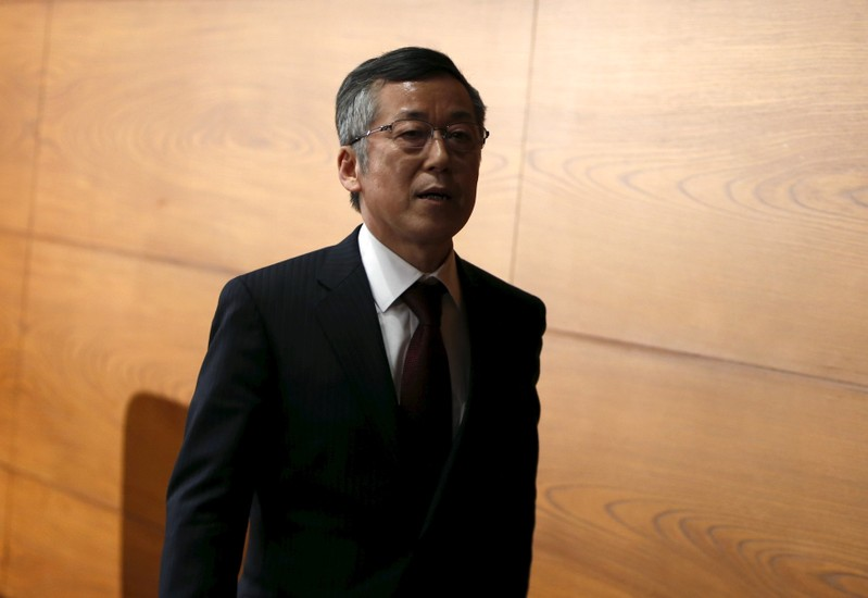 Newly-appointed Bank of Japan board member Harada leaves a news conference at the BOJ headquarters in Tokyo