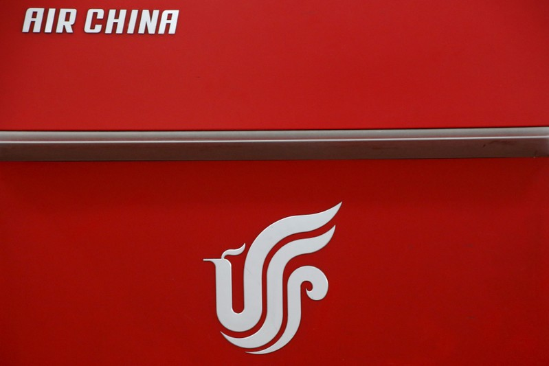 Air China's logo is seen on a counter of Air China at a terminal of Beijing Capital International Airport in Beijing