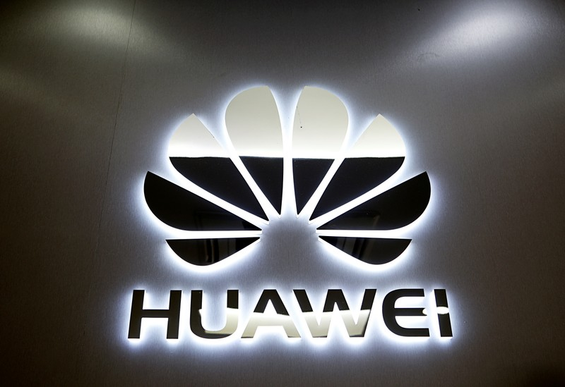 The logo of Huawei is pictured at a mobile phone shop in Singapore