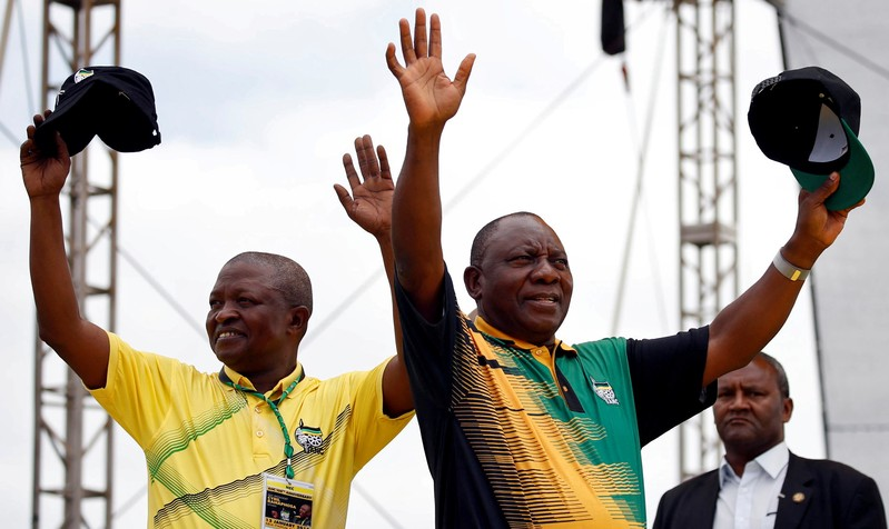 FILE PHOTO: President of the ANC Cyril Ramaphosa and his deputy David Mabuza wave to supporters ahead of the ANC's 106th anniversary celebrations in East London