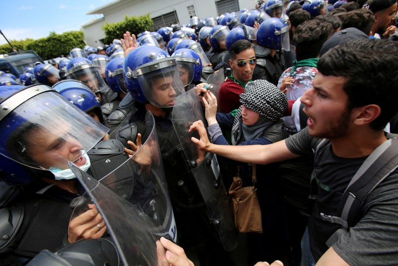 FILE PHOTO: Students and police confront each other during an anti-government protest in Algiers