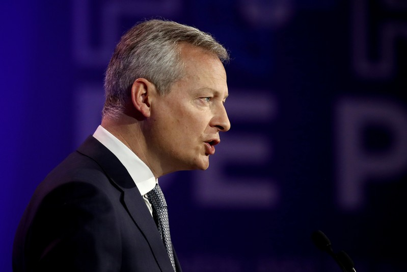 FILE PHOTO: French Economy and Finance Minister Bruno Le Maire delivers a speech during a high-level forum on debt at the Finance ministry in Paris