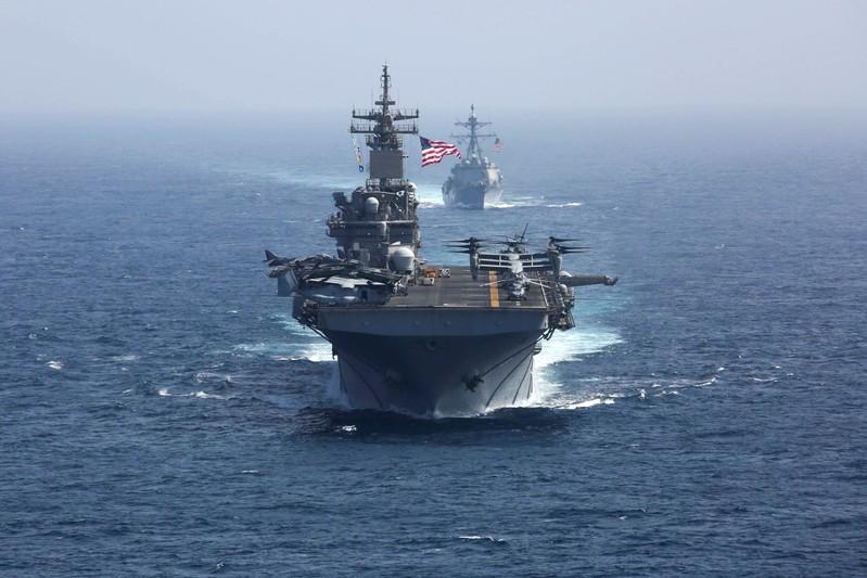 FILE PHOTO: The U.S. Navy amphibious assault ship USS Kearsarge and the Arleigh Burke-class guided-missile destroyer USS Bainbridge sail in the Arabian Sea