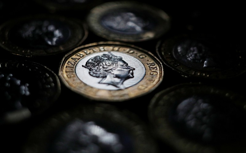 Pound coins are seen in the photo illustration taken in Manchester, Britain