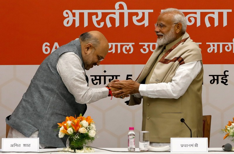 India's PM Modi shakes hands with BJP President Amit Shah during a thanksgiving ceremony by BJP leaders to its allies at the party headquarters in New Delhi