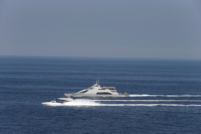 FILE PHOTO: Iranian Revolutionary Guards speed boats are seen near the USS John C. Stennis CVN-74 as it makes its way to gulf through strait of Hormuz