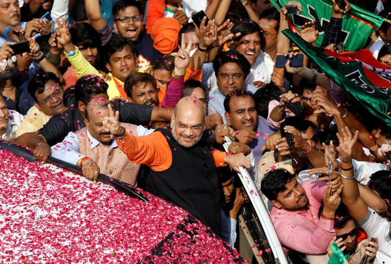 Bharatiya Janata Party President Amit Shah arrives at the party headquarters after learning the initial election results, in New Delhi,