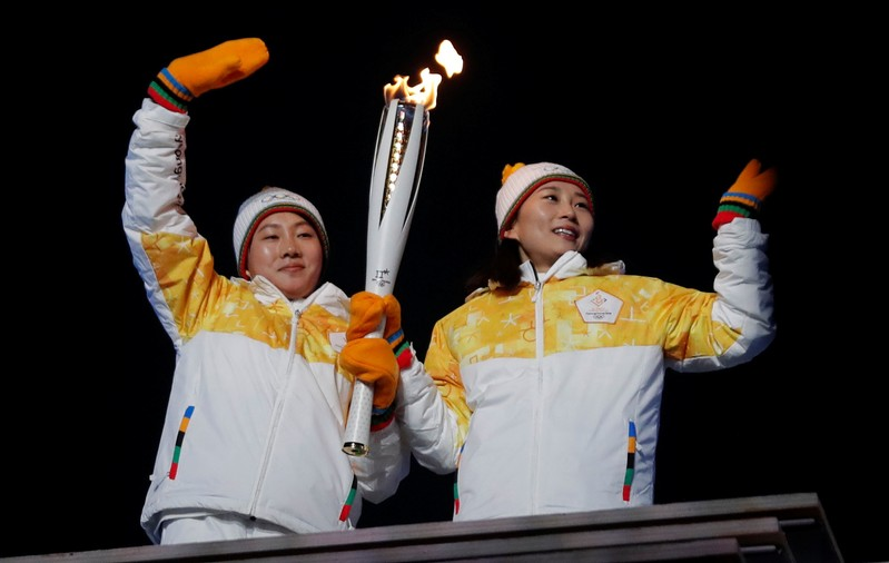 FILE PHOTO: Hockey players from the unified Korean team carry the Olympic flame during the opening ceremony at the Pyeongchang 2018 Winter Olympics
