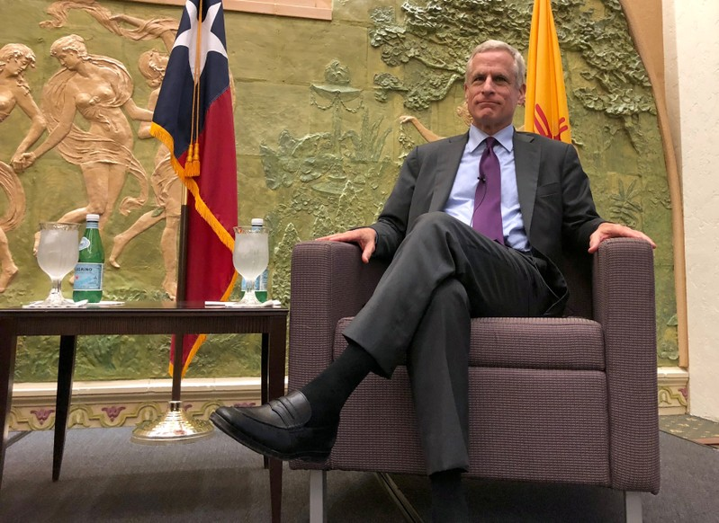 FILE PHOTO: Dallas Federal Reserve Bank President Robert Kaplan poses at a luncheon in El Paso