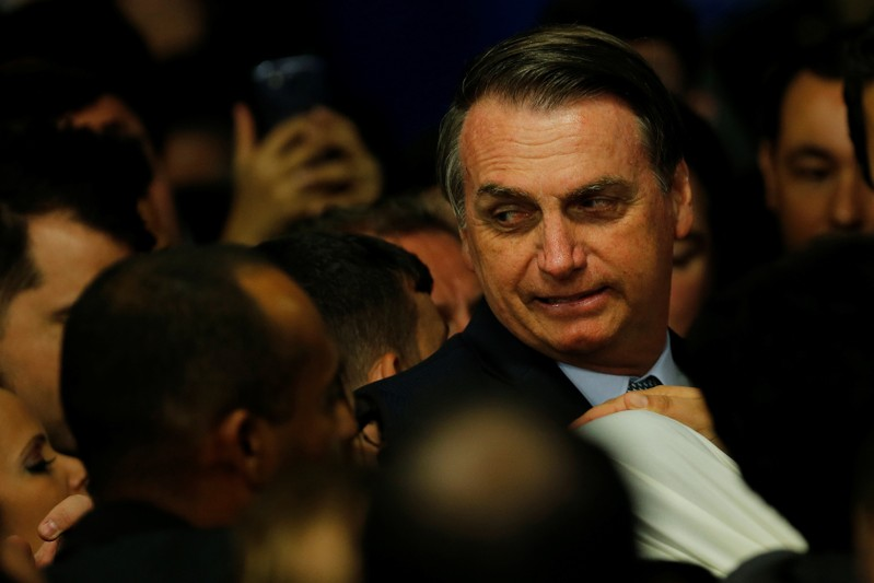 FILE PHOTO - Brazilian President Jair Bolsonaro attends a ceremony of consecration of Saint Mary of the Immaculate Conception at the Planalto Palace in Brasilia