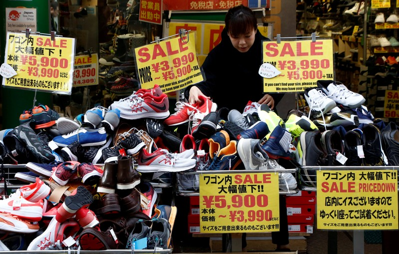 FILE PHOTO: A clerk arranges shoes at a shop in Tokyo