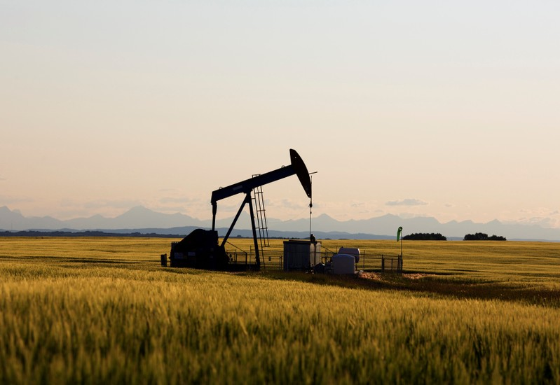 FILE PHOTO: An oil pump jack pumps oil in a field near Calgary