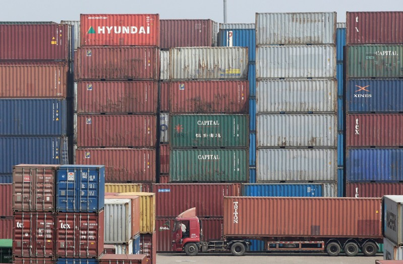 A container is transported into a logistics center near Tianjin Port