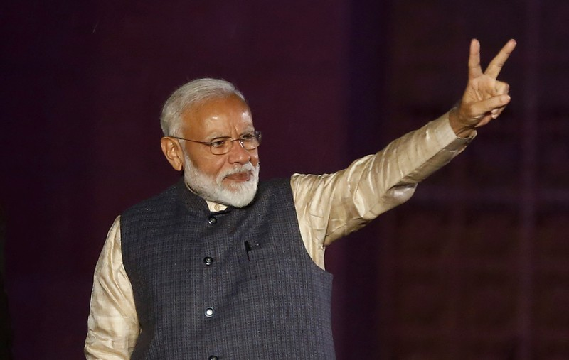 Indian Prime Minister Narendra Modi gestures towards his supporters after the election results at Bharatiya Janata Party (BJP) headquarter in New Delhi