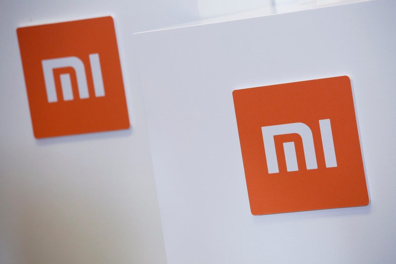 Xiaomi logos are displayed during a news conference in Hong Kong