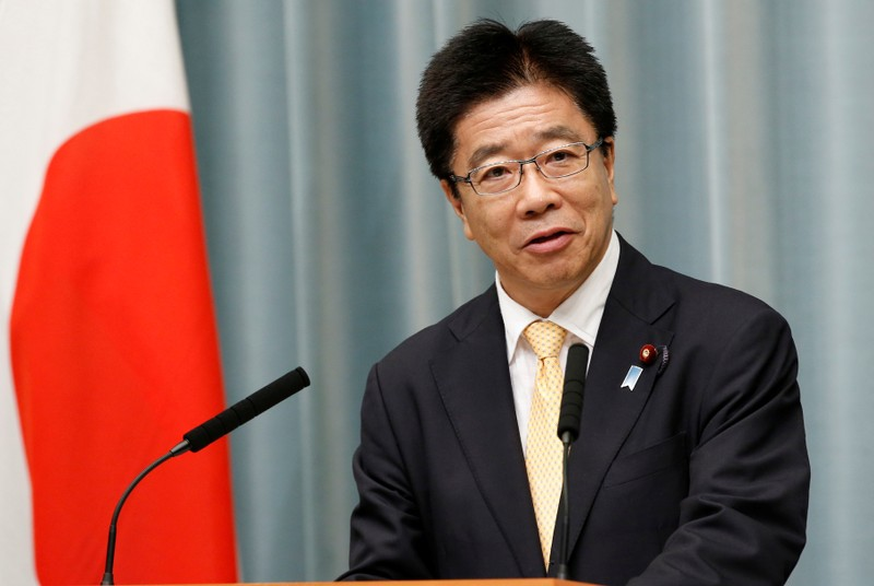 FILE PHOTO: Japan's Health, Labour and Welfare Minister Katsunobu Kato speaks at a news conference in Tokyo