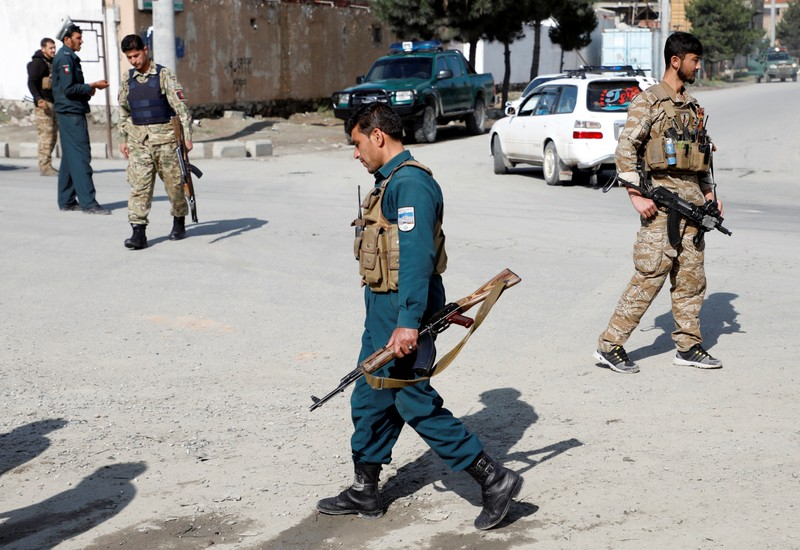Afghan security forces keep watch outside a mosque after a blast in Kabul