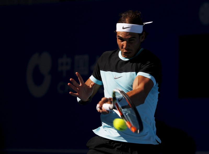 Rafa Nadal of Spain hits a return against Fabio Fognini of Italy during their men's singles semifinal match at the China Open tennis tournament in Beijing