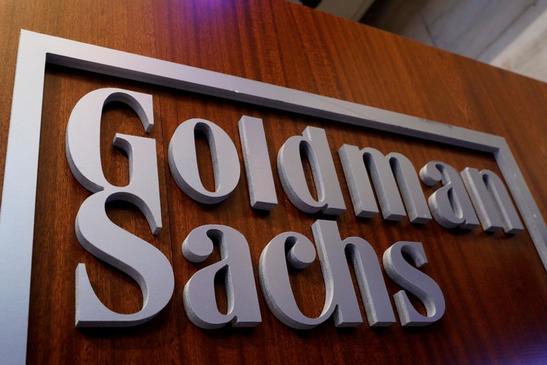 FILE PHOTO: A Goldman Sachs sign is displayed inside the company's post on the floor of the NYSE in New York